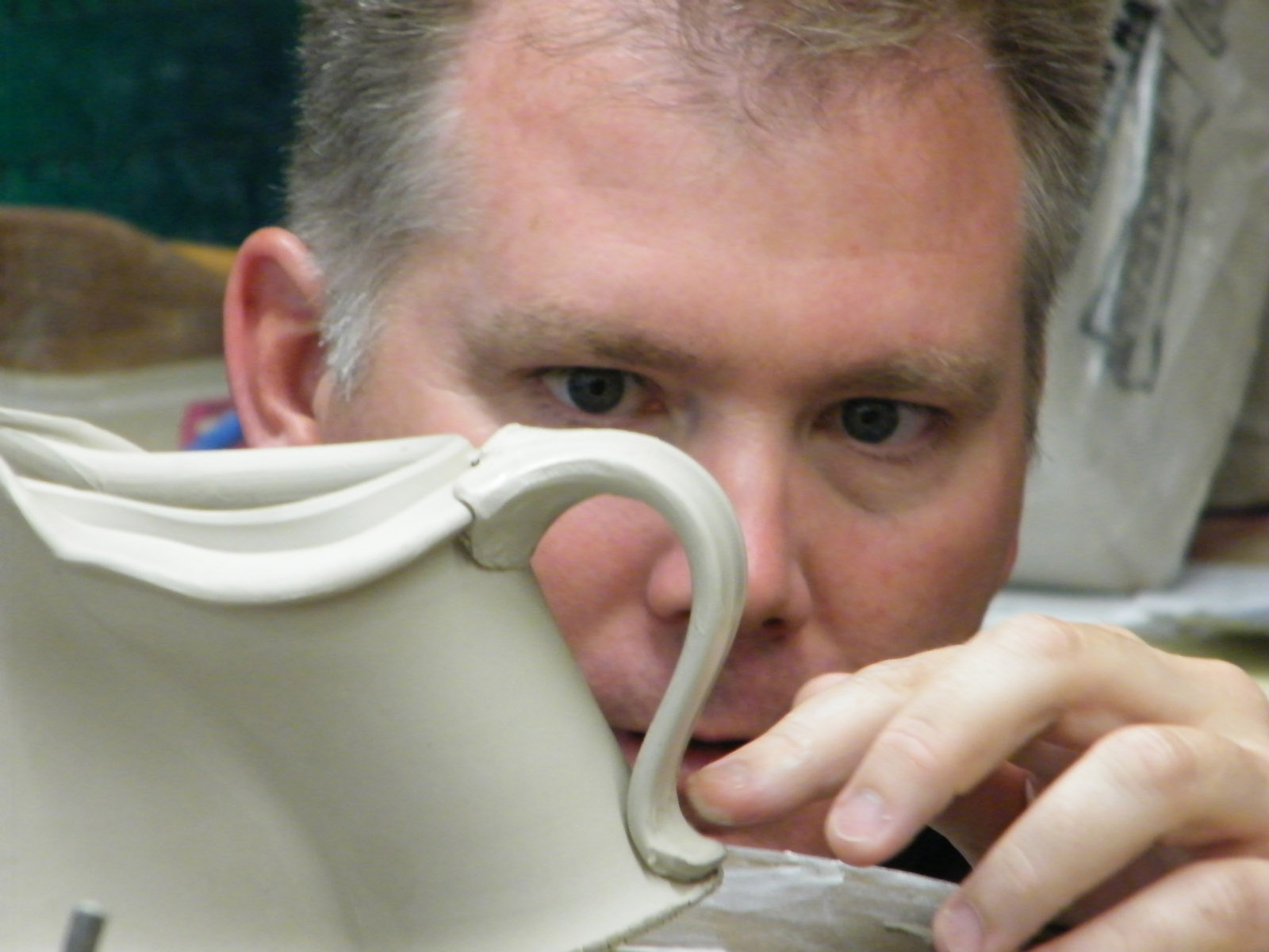 conner burns looking through a handle of a creamer while teaching a workshop at missa